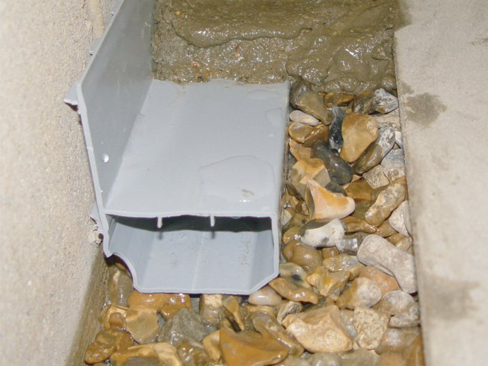 interior basement drain installation in quebec basement drain